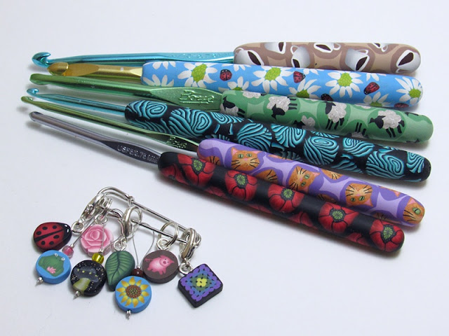 Pretty handmade stitch markers, storage tins and crochet hook handles from Noelle Lewis Art