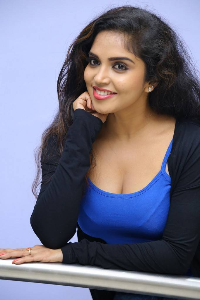 Karunya Chowdary in lovely Blue Sleevless Tank Top at Seertha Ramuni Kosam Movie First Look Launch