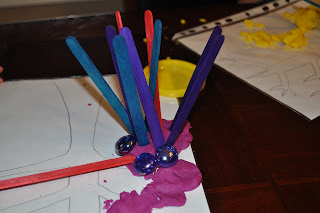 invitation to play with play-dough and craft materials