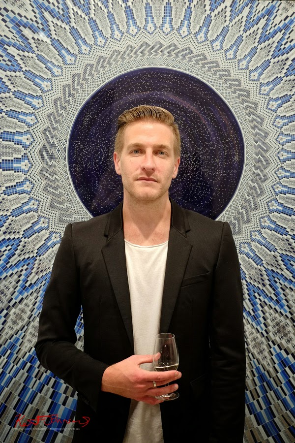 Artist Portrait of Lucas Grogan with painting A Pale Blue Dot - Martin Browne Contemporary - Kent Johnson for Street Fashion Sydney.