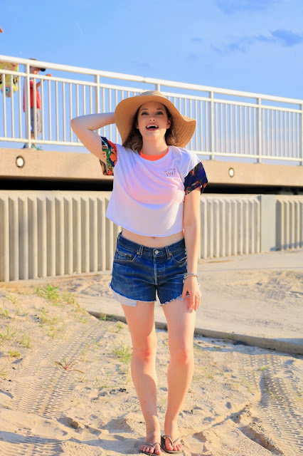 Nyc fashion blogger Kathleen Harper wearing denim cutoff shorts at the beach