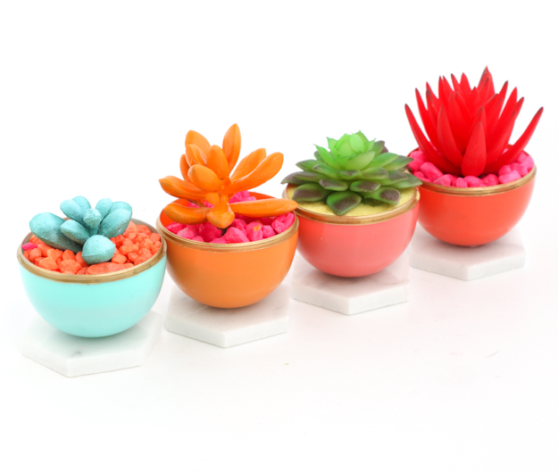 Craft and DIY Mini Neon Succulent Planters using colorful play sand or aquarium rocks and painted succulents in gold edged Easter egg and Marble Planters