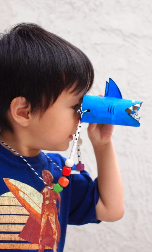 Make a pair of shark binoculars with the kids!  Fun way to reuse toilet paper rolls!