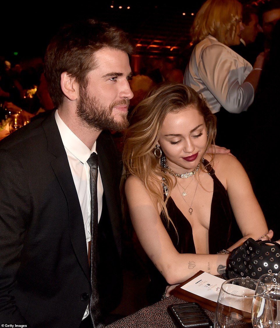 Liam Hemsworth and Miley Cyrus inside the G'Day USA Gala