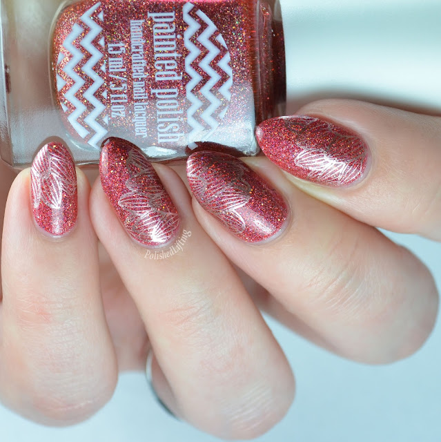 Holographic red nail polish with gold flowers