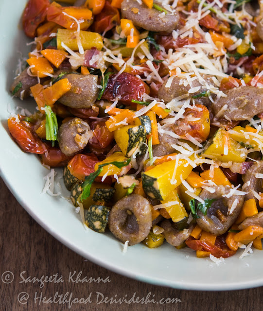 whole grain pasta with pumpkin carrots and cherry tomatoes