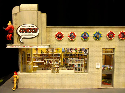 Modern dolls' house miniature comic book shop in an art deco building