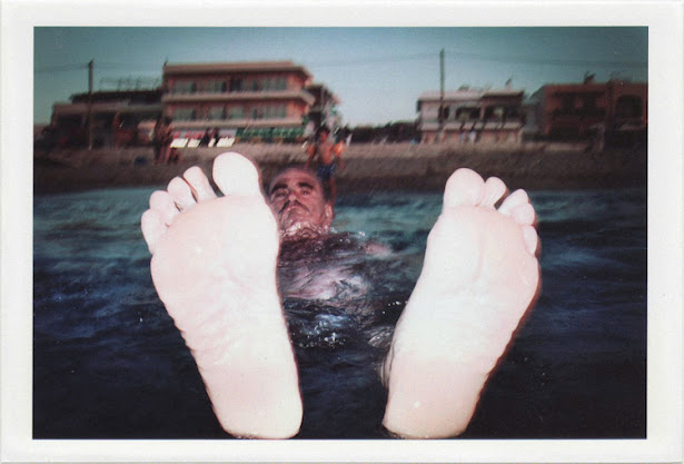 dirty photos - on the island of - photo of man's feet flashed inside sea
