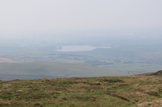 Below in the valley, Hollingworth Lake can just be made out through the haze.