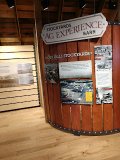 information is displayed on wooden plank walls at the Sioux Falls Stockyards Ag Experience museum