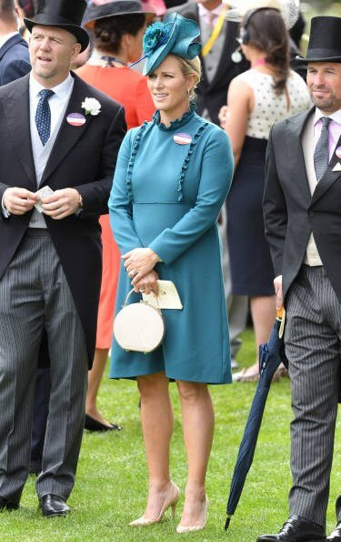 The Countess of Wessex wore a  wide-leg jumpsuit by Emilia Wickstead. Princess Eugenie wore a belted silk satin midi dress by Cefinn