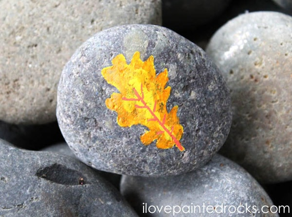 How to paint fall leaves on a painted rock with posca pens and acrylic paint