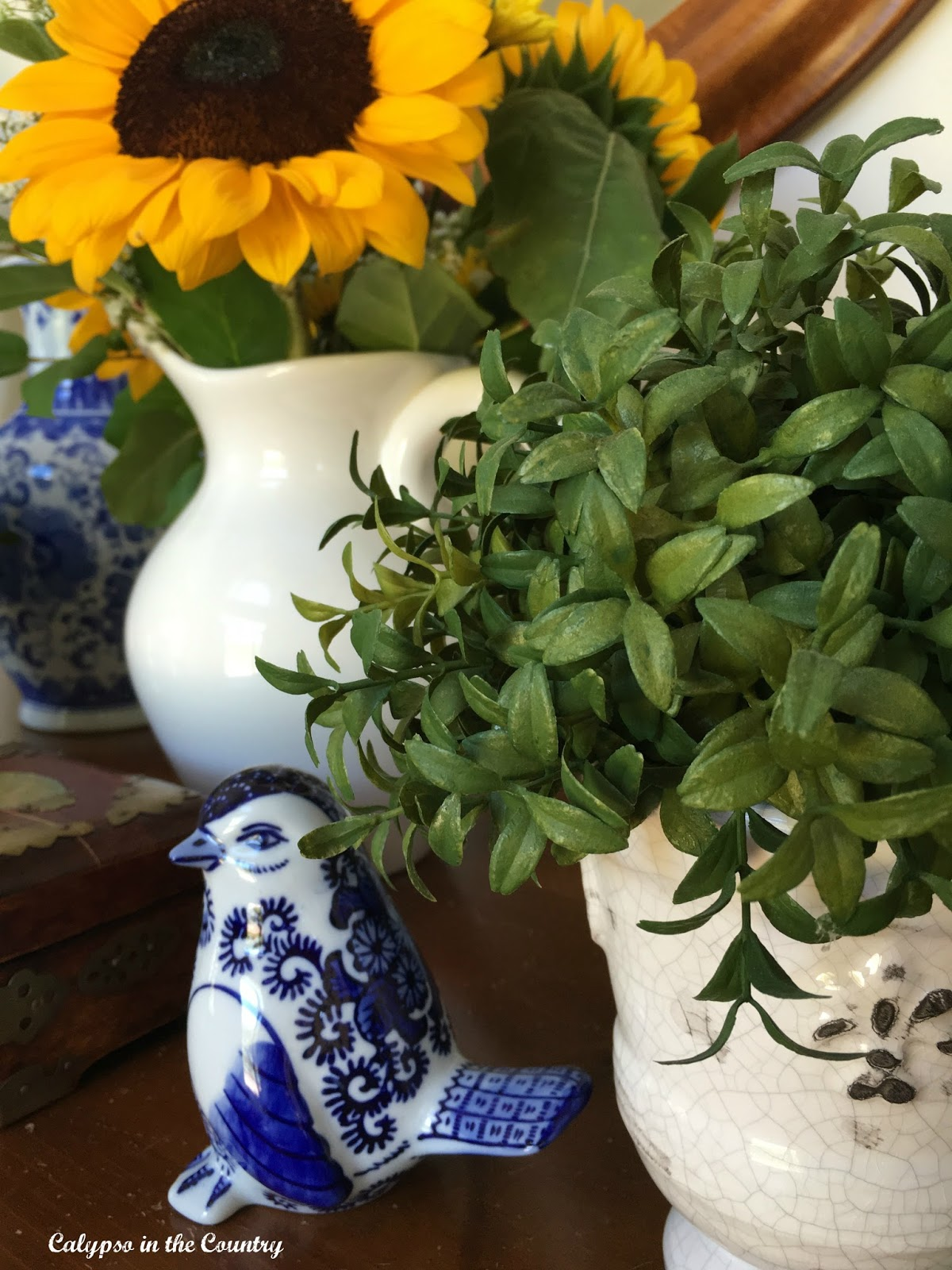 Sunflowers and blue and white porcelain bird