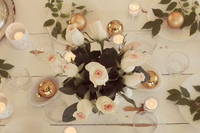 Romantic modern farmhouse feminine tablescape on white farmhouse table with blush roses gold and green