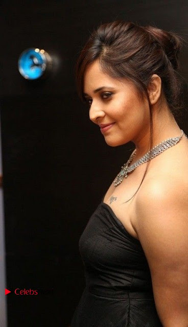 Telugu Anchor Actress Anasuya Bharadwa Stills in Strap Less Black Long Dress at Winner Pre Release Function  0007.jpg