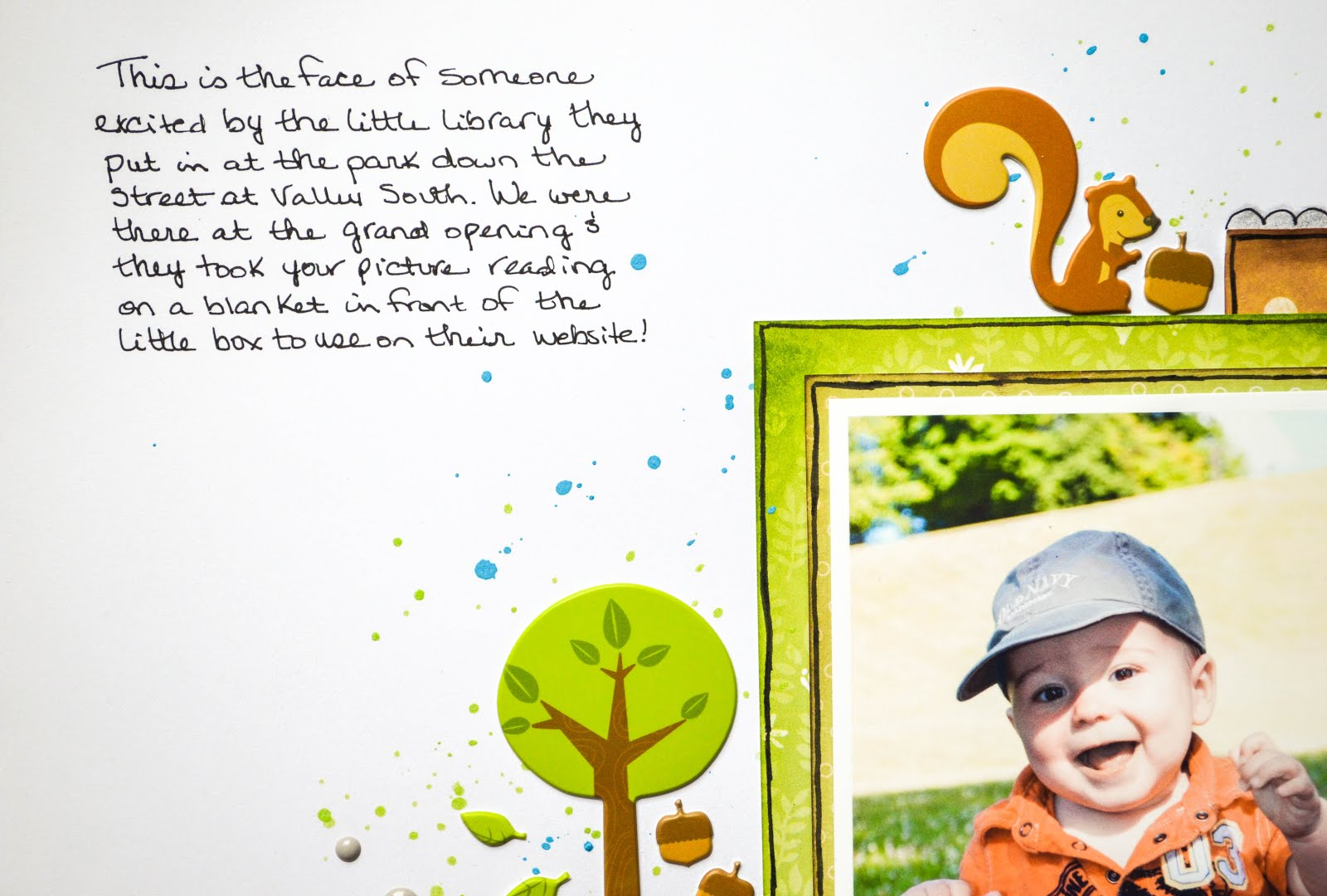 Little boy scrapbook layout with forest animals, paper layering, puffy stickers, enamel dots in green, orange, and blue on white background