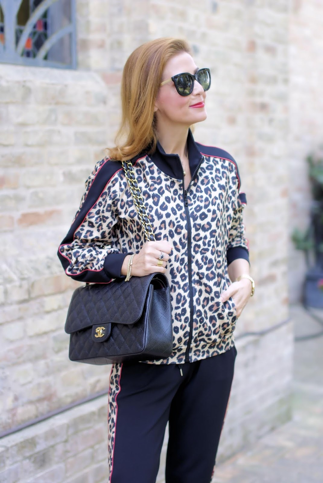 The animal print trend: leopard print tracksuit and Chanel bag on Fashion and Cookies fashion blog, fashion blogger style