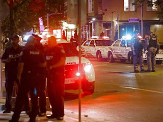GUNMAN KILLS YOUNG WOMAN, INJURING 13 OTHER PEOPLE IN TORONTO