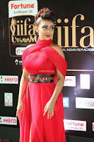 Apoorva in a Stunning Tight Leg Split Sleeveless Red Gown at IIFA Utsavam Awards 01.JPG