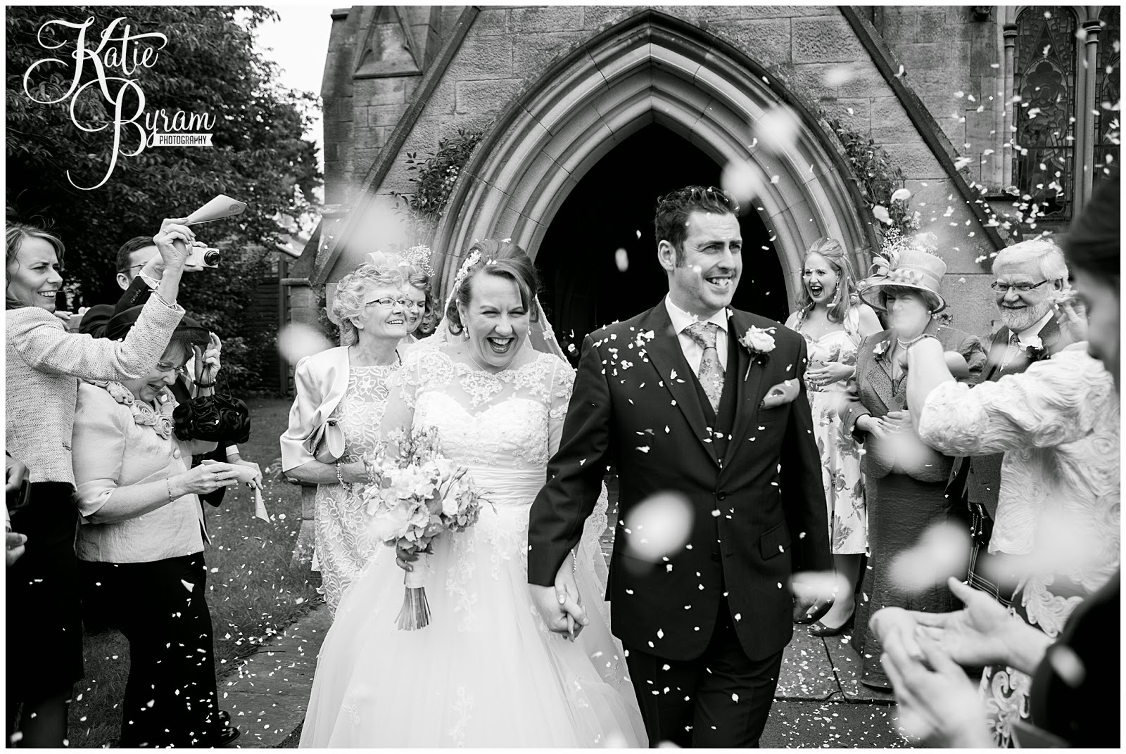 black and white wedding photograph, confetti shot, minsteracres wedding, lord crewe arms wedding, dog at wedding, scoops and smiles, katie byram photography, ice cream van hire newcastle, newcastle wedding photography, relaxed wedding photography, quirky, 50