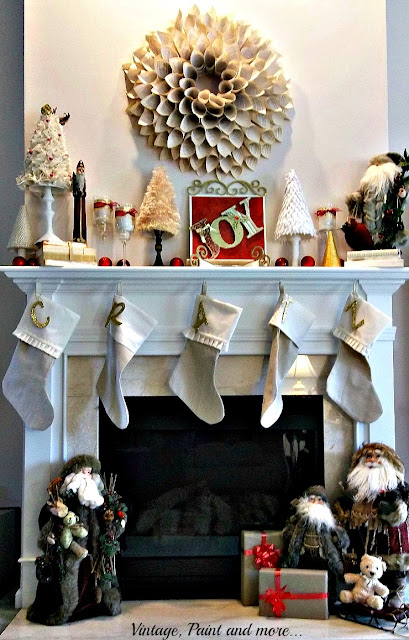 Vintage, Paint and more... Christmas Mantel with diy stocking from drop cloth, diy trees of burlap, felt, silk and gold cord, fun fur yarn, book page wreath, vintage Santas and diy JOY sign