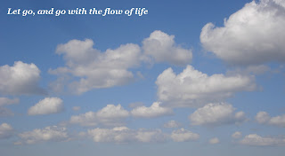Clouds on a blue sky. Let go, and go wtih the flow of life.