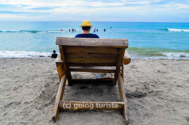 A beach with a wooden bench in Zambales Philippines
