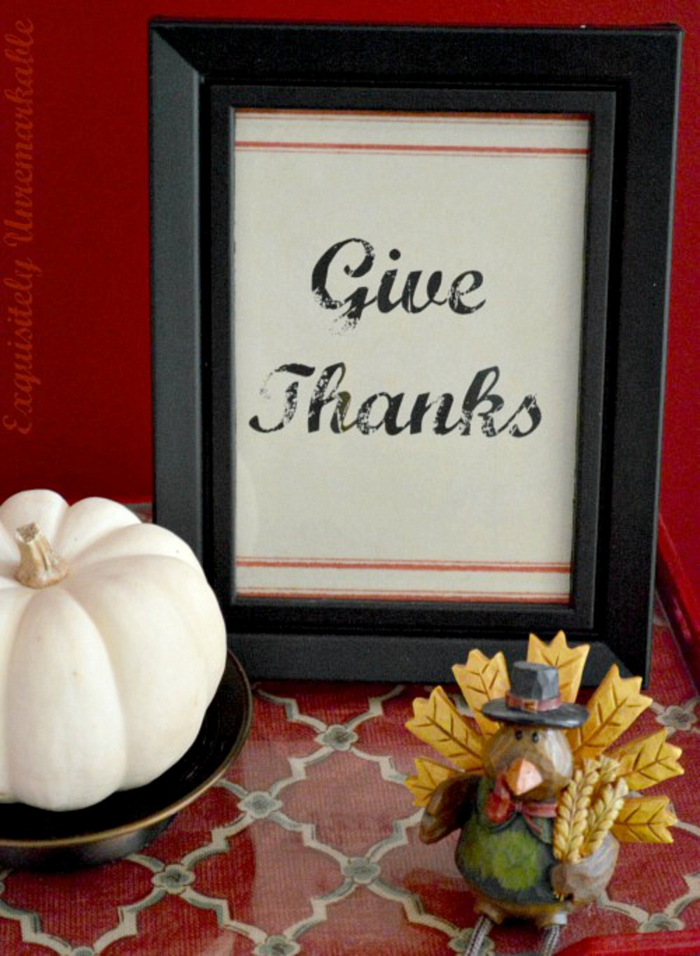 Free Give Thanks Printable for Thanksgiving on table with turkey statue and pumpkin