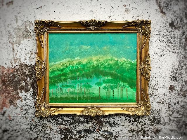 green art print, in a gold ornate frame
