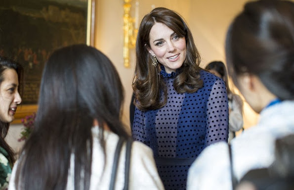 Prince William and his wife The Duchess of Cambridge attended a reception with young people from India and Bhutan at Kensington Palace, Kate Middleton wore SALONI Mary Illusion Dot Dress