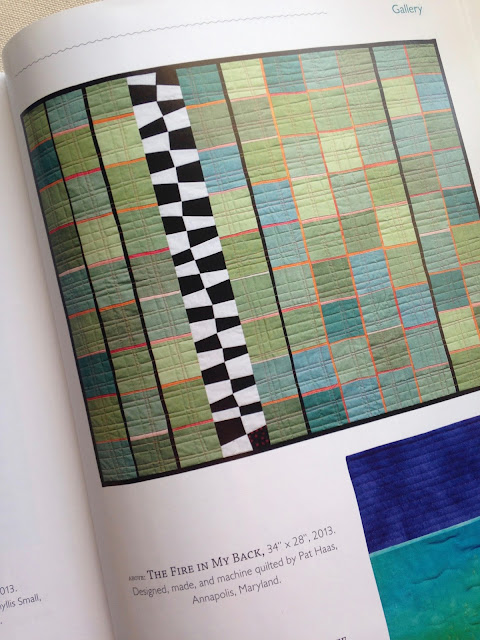 "Photo from a book showing quilt ""The Fire in My Back"" by Pat Haas"