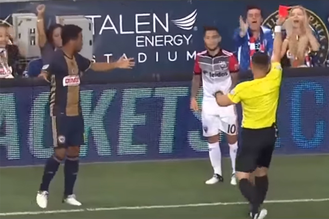 D.C. United player Luciano Acosta shown a red card by referee Sorin Stoica