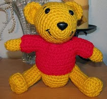 http://www.ravelry.com/patterns/library/crocheted-pooh-bear-lookalike-doll