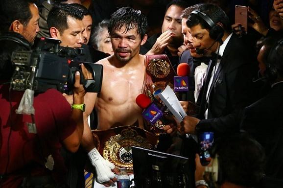Manny Pacquiao resmi menggantung sarung tinjunya,usai memenangkan duel perebutan WOB