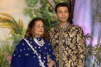 Karan Johar wears Abujani Sandeep Khosla at Kapoors' Reception.