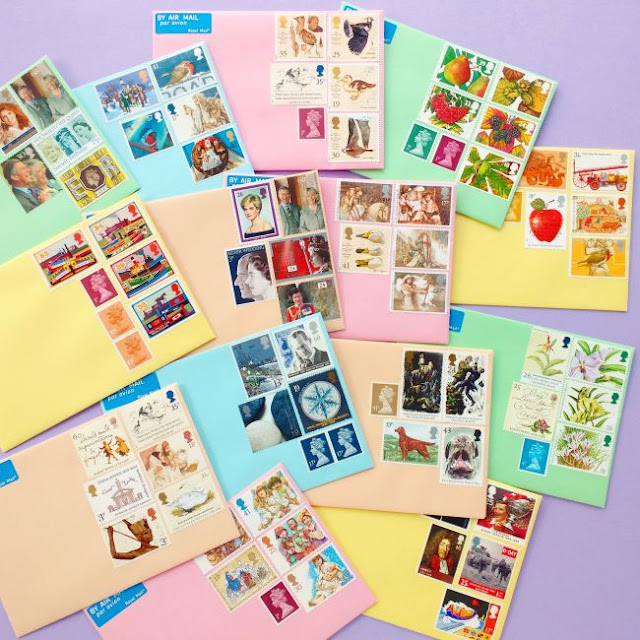 colourful envelopes decorated with vintage postage stamps