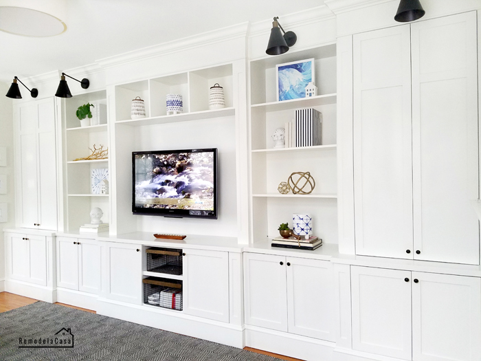 White built-in  unit with tv in family room