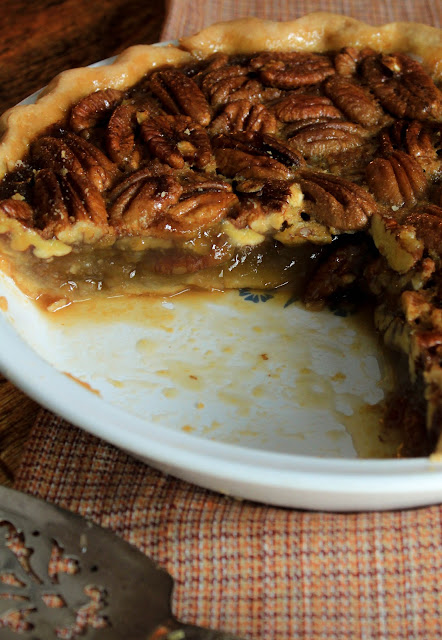 Maple Pecan Pie, a sweet, deep flavor of maple syrup complementing the richness of pecans in a classic pecan pie.  Perfect for any Thanksgiving meal!