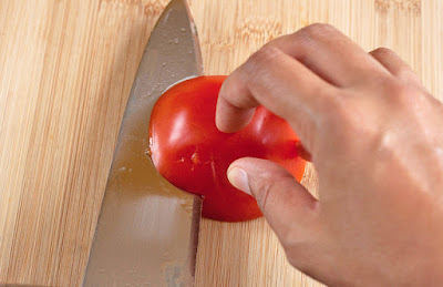Slicing across the tomato horizontally