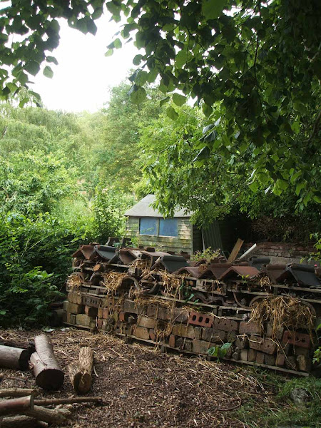impressive example of a large bug house, bug hotel at windmill hill city farm, example of eco friendly gardening