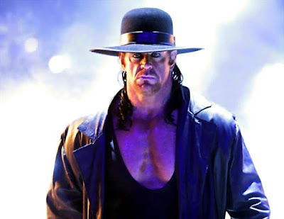 30-years after, The UNDERTAKER retires, leaves gear in WrestleMania ring