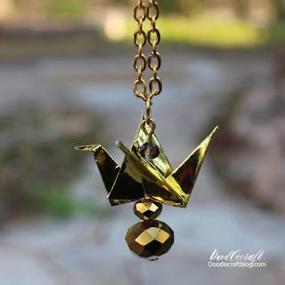 http://www.doodlecraftblog.com/2016/08/gold-paper-crane-necklace.html
