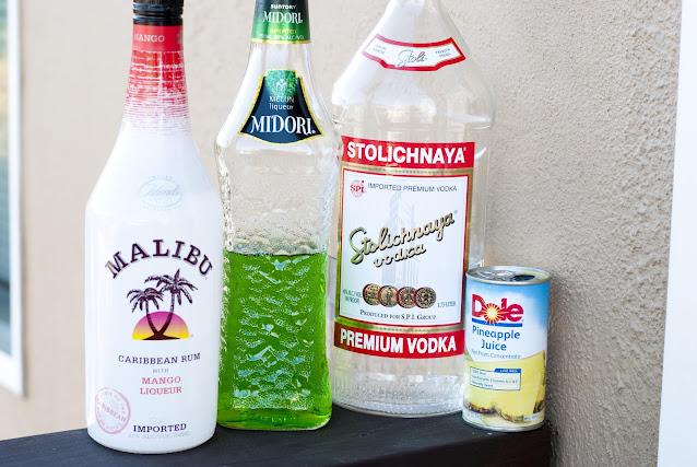dirty swinger, melon liqueur, midori, pineapple juice, vodka, malibu mango rum, coconut mango rum