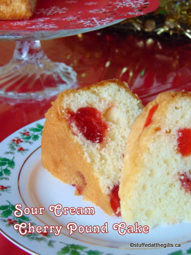 A Christmas plate with two slices of Sour Cream Cherry Pound Cake.