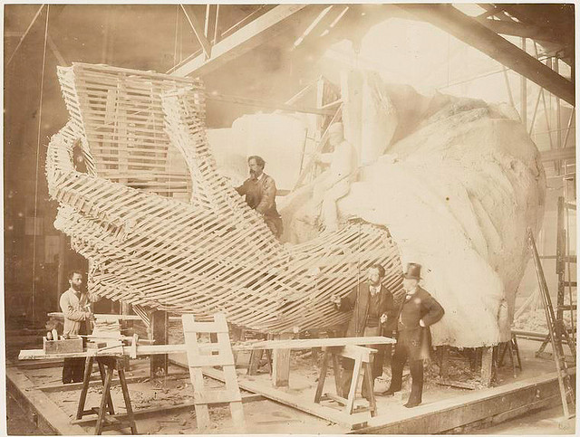 [Construction of the skeleton and plaster surface of the left arm and hand of the Statue of Liberty.]. Fernique, Albert -- Photographer. 1883. Source: Album de la construction de la Statue de la Liberte. Repository: The New York Public Library. Photography Collection, Miriam and Ira D. Wallach Division of Art, Prints and Photographs.