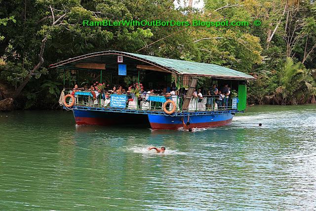 Kids hang on boar for joyride, Loboc River, Bohol, Philippines