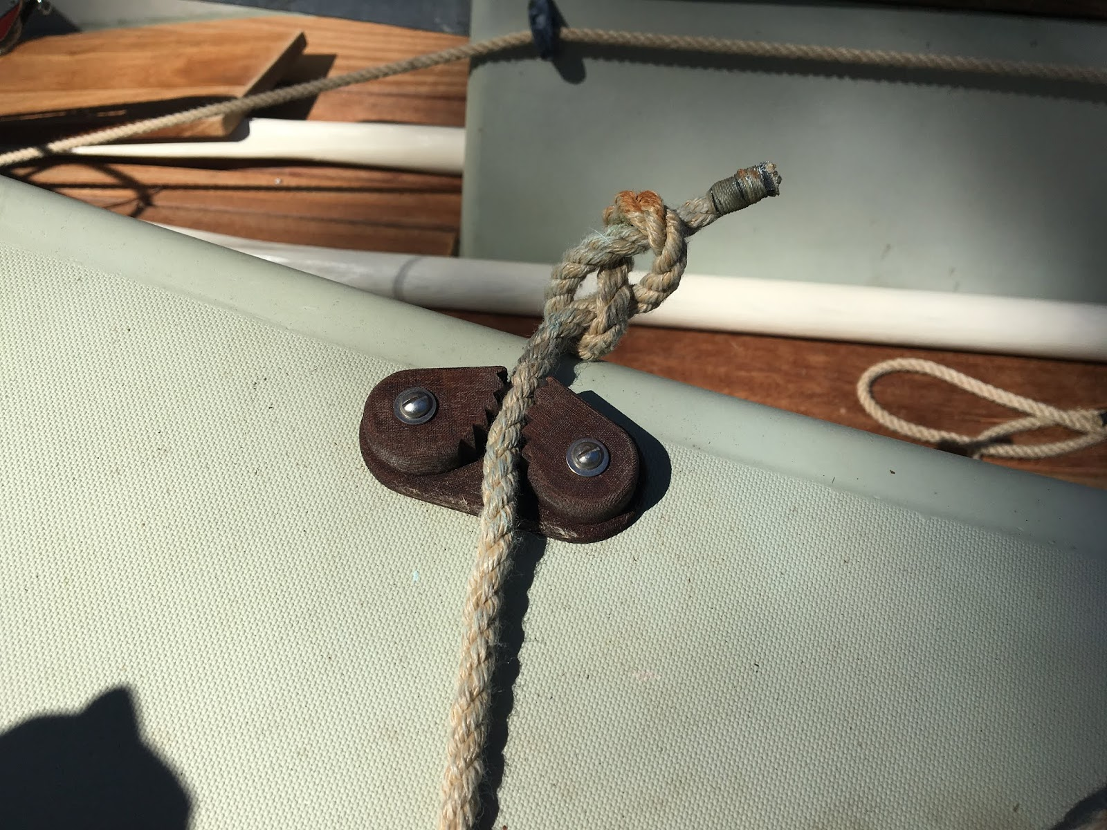 we add a few wraps of line around the jib tack loop keeps it from slipping some boats have a dowel there and others have roller furling
