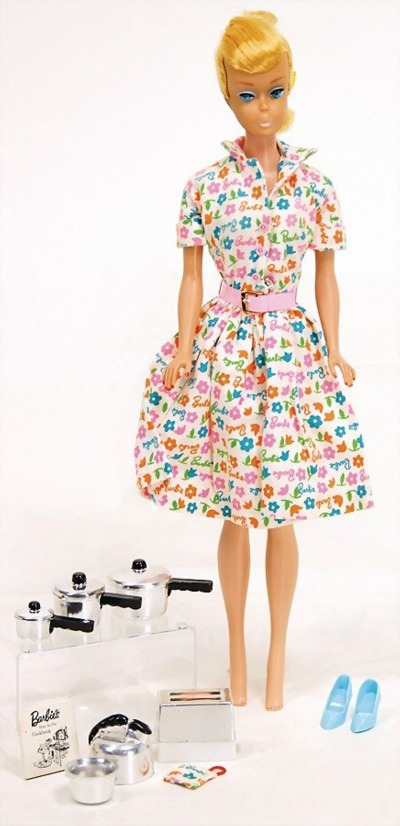 Barbie in floral dress with cooking utensils