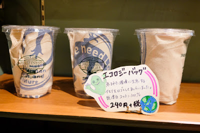 """Ecology Pack"" cotton towels for sale at Freshness Burger, Asakusabashi Branch, Tokyo."