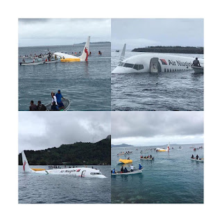 Plane overshoots runway, lands in the ocean